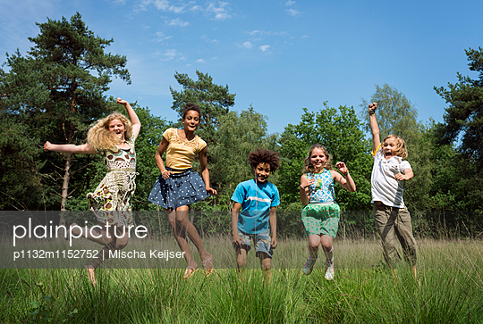 Kids play in the woods - p1132m1152752 by Mischa Keijser