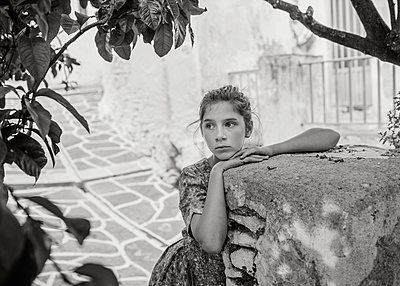 Girl Waiting in Village - p1503m2015905 by Deb Schwedhelm