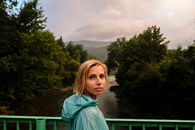 Portrait of a young woman in a raincoat - p1363m2063267 by Valery Skurydin