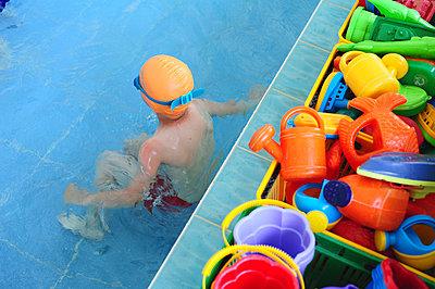 Children learn to swim in the indoor pool - p1412m1466348 by Svetlana Shemeleva