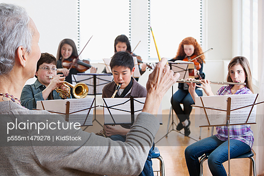 Teacher instructing students in music class