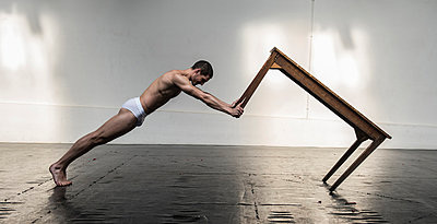 Dancer with table - p1139m924469 by Julien Benhamou