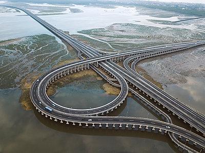 Aerial view of bridge in the sea - p1166m2111837 by Cavan Images