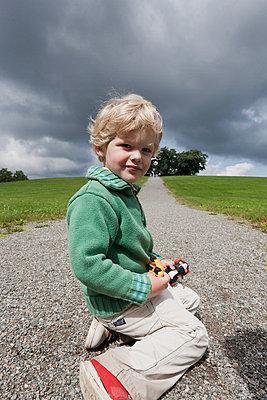 Boy at park - p4267723f by Ulf Börjesson