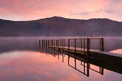 Sunrise over Derwent Water from Hawes End jetty in autumn, Lake District National Park, Cumbria, England, United Kingdom, Europe - p8713045 by Adam Burton