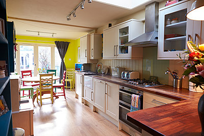 Interior Of Apartment Showing Kitchen And Dining Areas - p1407m1507598 by Monkey_Images