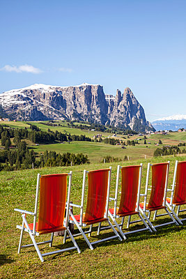 Row of loungers in mountains - p312m2174880 by Marie Linnér