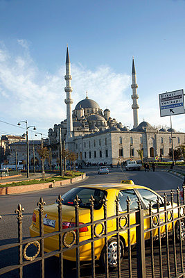 Turkey, Istanbul, Exterior of Mosque Yeni Camii(1597) and yellow taxi; Eminonou - p442m839939 by Marc Jackson