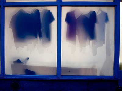 Shirts behind a window - p4451218 by Marie Docher