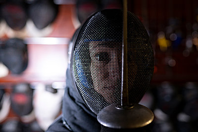 Woman in fencing mask at gym - p300m2243501 by Jose Carlos Ichiro