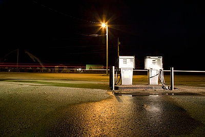 Fuel pumps at night - p4297906 by Hugh Whitaker