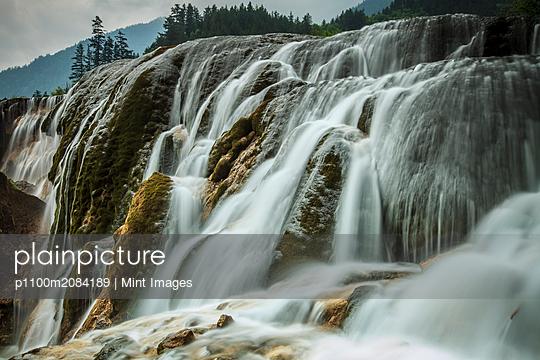 Waterfall in rural landscape,Jiuzhaigou, Sichuan, China - p1100m2084189 by Mint Images