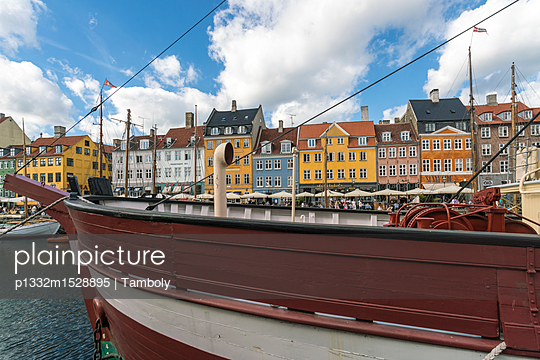 Nyhavn with old ships anchored - p1332m1528895 by Tamboly