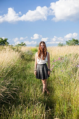Young woman on a meadow - p502m924237 by Tomas Adel