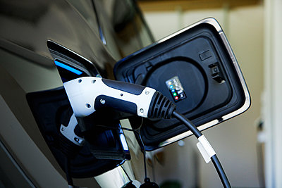 Electric Car Charging, Close-up View - p669m927486 by Jutta Klee photography