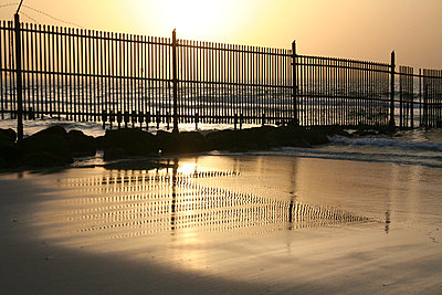 Sunset and fence at seaside - p1620031 by Beate Bussenius