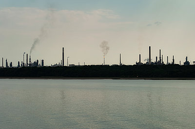 Oil Refinery view from the sea - p1047m1578317 by Sally Mundy