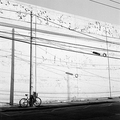 The white wall and bike  - p1063m1132350 by Ekaterina Vasilyeva