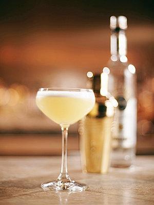 Glass of fruity cocktail on bar - p429m662261f by Egill Bjarki