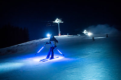 France, Skier at night - p1007m2216551 by Tilby Vattard