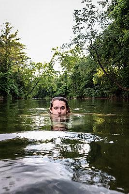 Girl in Creek - p1019m2100443 by Stephen Carroll