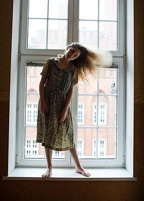 Girl Standing on Window Ledge - p1503m2015849 by Deb Schwedhelm