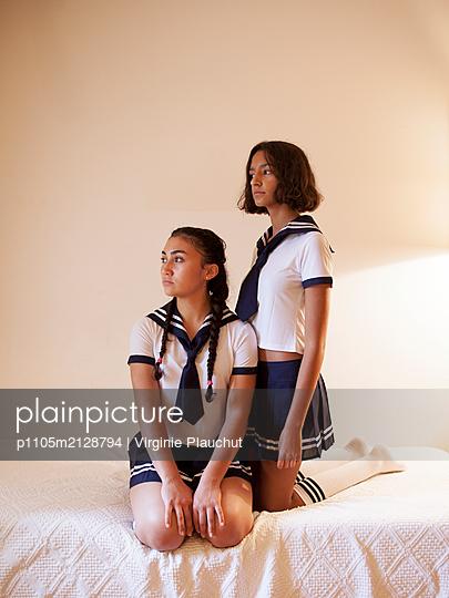 Two girls wearing sailor suit - p1105m2128794 by Virginie Plauchut