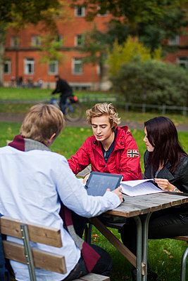 Three young university students studying at college campus - p426m747289f by Astrakan
