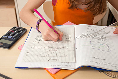 Close up of girl doing math's homework - p609m660398f by STUDD