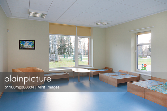 Modern day care nursery or pre-school kindergarten school, bedrooms for nap time - p1100m2300884 by Mint Images
