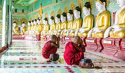 Asian Buddhist monks praying in temple, Mingun, Saigang, Myanmar,Mingun, Saigang, Myanmar - p1100m2084193 by Mint Images