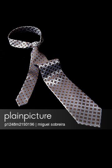 Tie on black background - p1248m2193196 by miguel sobreira
