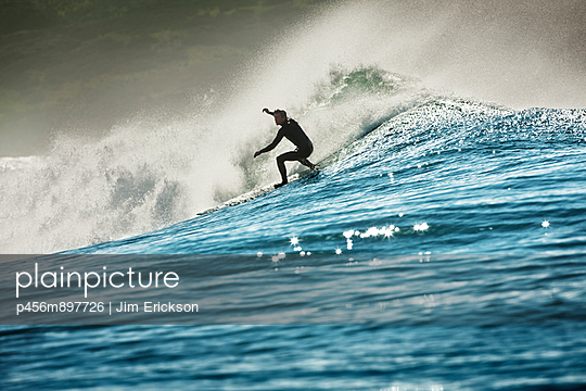 Surfer riding a large wave. - p456m897726 by Jim Erickson