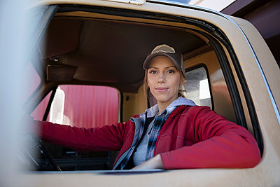 Portrait confident female farmer driving truck - p1192m2040005 by Hero Images