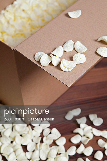 A cardboard box and packing peanuts