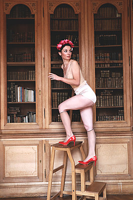 Woman in lingerie and high heels in library - p1521m2214971 by Charlotte Zobel