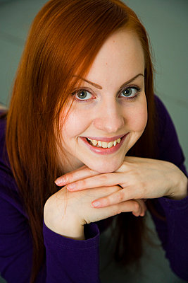 Woman smiling - p4130476 by Tuomas Marttila