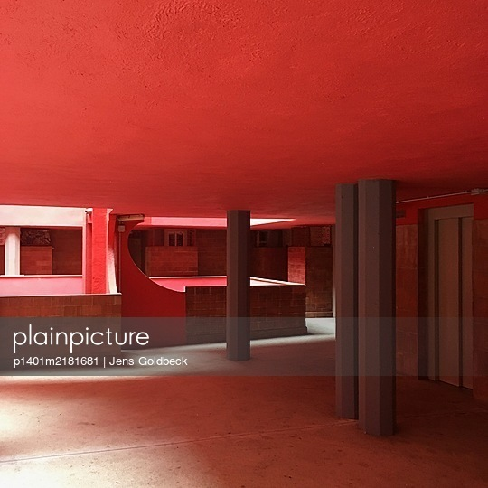 Red staircase and lift, architectural style, Ricardo Bofill  - p1401m2181681 by Jens Goldbeck