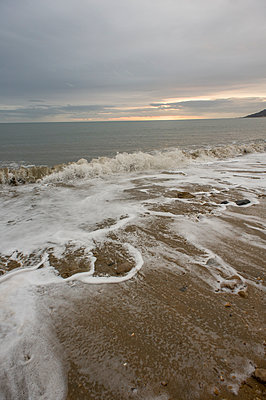 Waves breaking on Lyme Regis beach at sunset - p1433m1538865 by Wolf Kettler