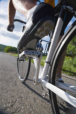 Close-up of a cyclist cycling on road - p3071156f by Picture  Press, G&L