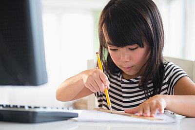 Filipino girl drawing at computer - p555m1415577 by JGI/Jamie Grill