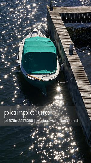 Single boat tied up at boardwalk - p1578m2278099 by Marcus Hammerschmitt