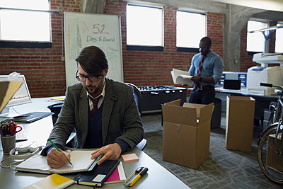 Entrepreneurs working in new office - p1192m1129605f by Hero Images