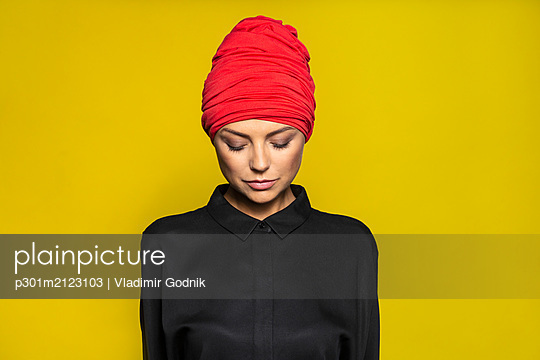 Portrait serene woman wearing headscarf - p301m2123103 by Vladimir Godnik