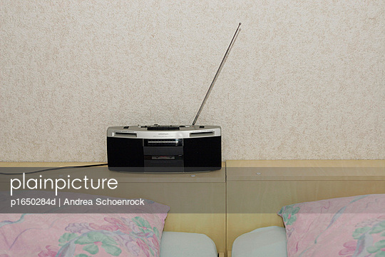 Radio and bed - p1650284d by Andrea Schoenrock