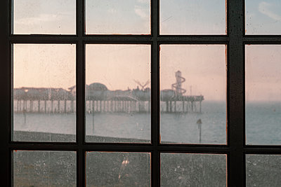 Herne Bay at dusk through an old window - p1228m2064601 by Benjamin Harte