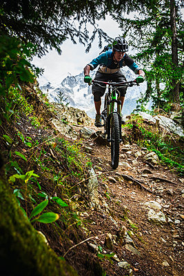 Mountain biker rides the trails of Chamonix, France. - p343m1090329 by Elias Kunosson