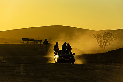 Driving at sunset, Damaraland; Kunene Region, Namibia - p442m2176935 by Dosfotos