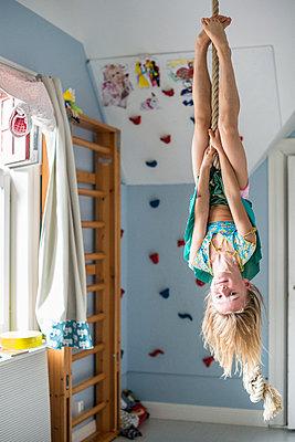 Girl hanging upside down - p312m1407616 by Fredrik Schlyter