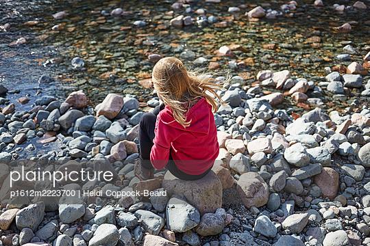 Young girl sat riverside  - p1612m2223700 by Heidi Coppock-Beard